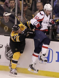 Bruins Paille checks Capitals Green at TD Garden in Boston, MA.