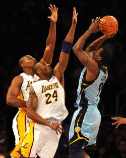 Los Angeles Lakers Andrew Bynum(L) and Kobe Bryant can't block shot of Memphis Grizzlies Tony Allen