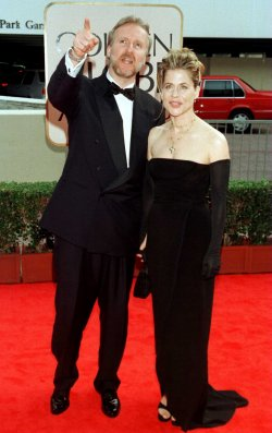 """James Cameron, the director of the motion picture epic """"Titanic"""" points out something to his wife Li"""