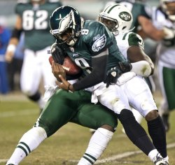 Philadelphia Eages quarterback Vince Young is sacked in the 4th quarter