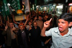 Palestinians protest against Israeli police action at Al-Aqsa Mosque in Jerusalem