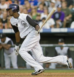 Rockies Fowler Lines Hit into Leg of Cubs Pitcher Gorzelanny in Denver