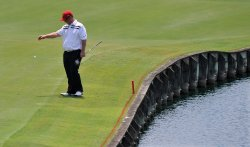 David Duval takes a drop during the TPC Players in Florida