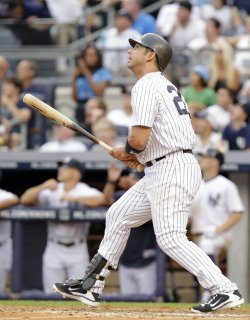New York Yankees Jorge Posada hits a grand slam home run at Yankee Stadium in New York
