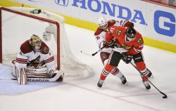Blackhawks' Kruger tries to score against Coyotes in Chicago