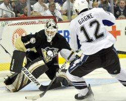 Lightning Simon Gagne takes a shot on Penguins goalie Brent Johnson in Pittsburgh