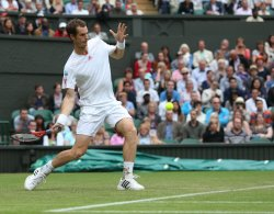 Andy Murray returns on the second day at Wimbledon Tennis Championships