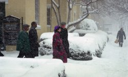 The Clintons walk back to the White House during the blizzard of 1996