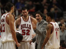 Bulls coach Del Negro talks with Noah, Miller and Rose in Chicago