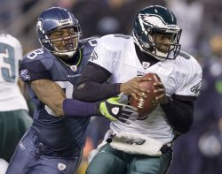Seattle Seahawks defensive end Raheem Brock pressures Philadelphia Eagles quarterback Vince Young at CenturyLink Field in Seattle.