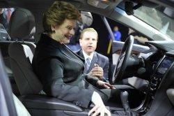 Sen. Stabenow looks at Cadillac at NAIAS in Detroit