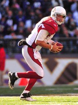 Cardinals quarterback Kevin Kolb scrambles in Baltimore