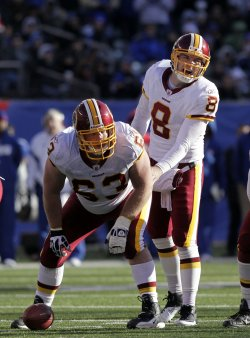 Washington Redskins Rex Grossman stands over Will Montgomery at MetLife Stadium in New Jersey