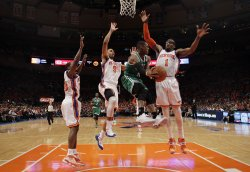 New York Knicks Jared Jeffries and Amar'e Stoudemire leap to defend Boston Celtics Rajon Rondo at Madison Square Garden in New York