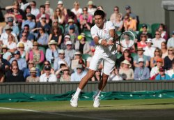 Novak Djokovic returns the ball in his match against Tommy Haas