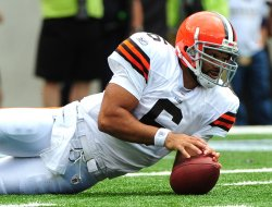 Browns' quarterback Seneca Wallace recovers a fumbled snap in Baltimore