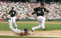 Chicago White Sox starting pitcher John Danks beats Boston Red Sox's Dustin Pedroia to first base in Chicago