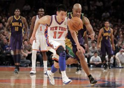 New Orleans Hornets Jarrett Jack and New York Knicks Jeremy Lin chase the basketball at Madison Square Garden in New York