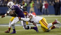 Washington Huskies quarterback Keith Price (17) is sacked by USC Trojans defensive end Leonard Williams (94) and linebacker Dion Bailey (18) in Seattle.