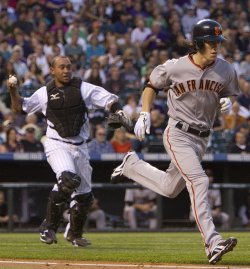 Rockies Catcher Olivo Throws Out Giants Pitcher Lincecum in Denver