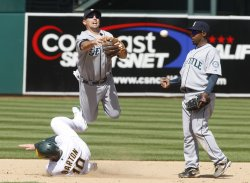 Oakland A's Daric Barton breaks up a double play against Seattle