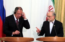Iranian Foreign Minister Ali-Akbar Salehi greets his Russian counterpart in Tehran
