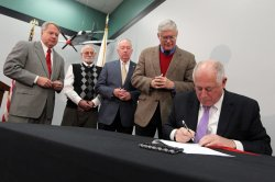 Illinois Governor signs legislation returning money to taxpayers