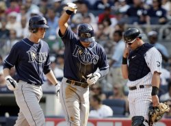 New York Yankees Francisco Cervelli reacts when Tampa Bay Rays Reid Brignac and Jason Bartlett cross home plate at Yankees Stadium in New York