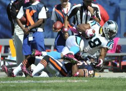 Bears Briggs tackles Panthers Stweart in Chicago