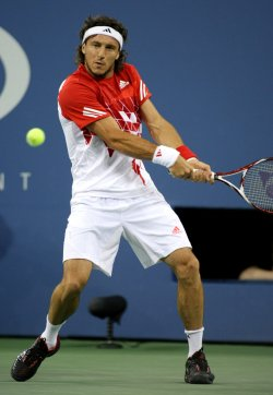Roger Federer and Juan Monaco compete at the U.S. Open in New York