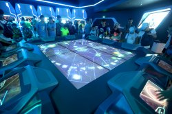 Chinese play a Tron video game in Shanghai Disneyland, China