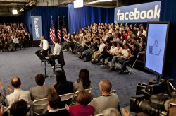 President Obama gets thumbs up after a town hall meeting at Facebook headquarters in Palo Alto, California