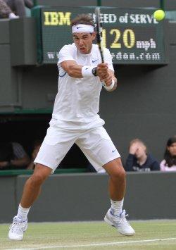 Rafael Nadal rreturns at Wimbledon.