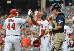Nationals' Adam Dunn connects for a home run in Washington