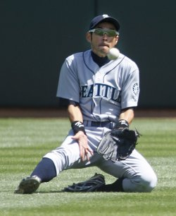 Seattle Mariners Ichiro Suzuki misses ball against the Oakland A's