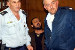 Israeli police surround Tanzim leader Marwan Barghouti in Tel Aviv District court