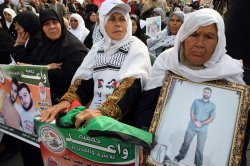 Palestinians Protest Calling for the Release of Imprisoned Relatives from Israeli Jails.