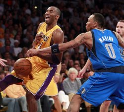 Los Angeles Lakers' Kobe Bryant, left, has the ball knocked loose by Dallas Maverick's Shawn Marion in the second half of Game 2 of the Western Conference semifinals May 4, 2011