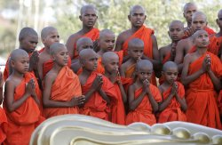 Indian Buddhist monks pray during the 2,555th Buddha Purnima in India