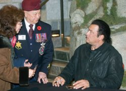 Actor and musician Steven Seagal signs autographs at River Rock Casino near Vancouver