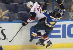 Arizona Coyotes Oliver Ekman-Larsson and St. Louis Blues Robert Bortuzzo collide
