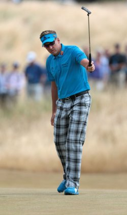 ian Poulter celebrates a putt on the 7th green at the Open Championship