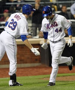 New York Mets Jason Bay and Ike Davis slap hands at Citi Field in New York