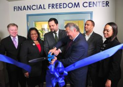 NAACP President and CEO Benjamin Todd Jealous and John Campbell, executive vice president of Social Responsibility at Wells Fargo participate in the ribbon cutting ceremony at the NAACP Financial Freedom Center in Washington