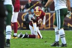 Redskins quarterback Rex Grossman is slow to get in Washington