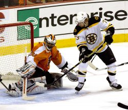 Boston's Michael Ryder takes a shot on goal during first period in Philadelphia