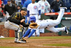 Cubs Castro scores as Pirates Doumit waits for throw in Chicago