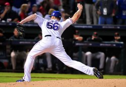 Rangers' pitcher Darren O'Day pitches in game 3 of the World Series in Texas