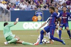 Neymar of Barcelona and Gianluigi Buffon of Juventus