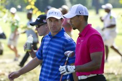 Harrington talks to Woods on 16th hole at 93rd PGA Championship